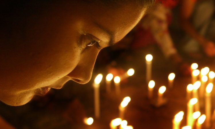 A woman in Mumbai commemorates the International Day for the Elimination of Violence against Women. (© AP Images)